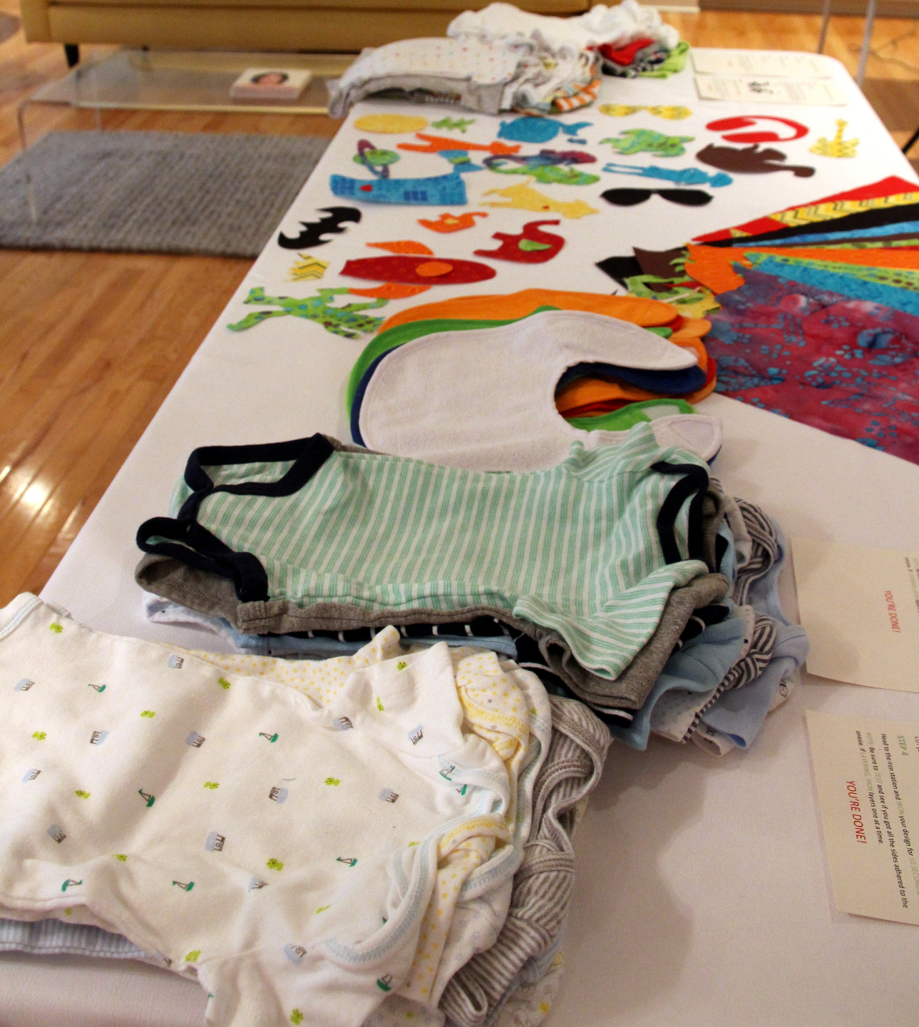 Guest Post Baby Shower Activity How To Make A Fabric Onesie Station