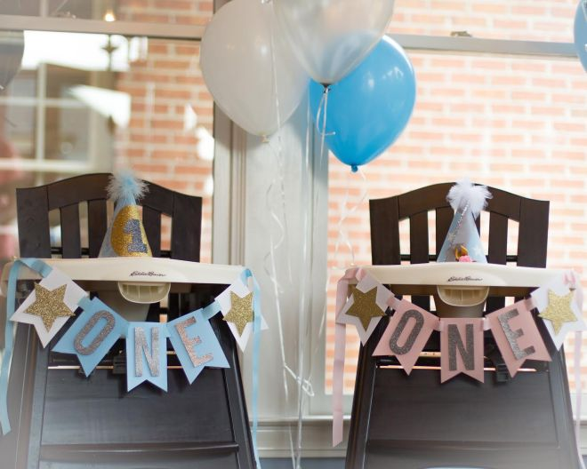 Highchairs decorated with banners and balloons. Notice the precious birthday hats! Photo: Headrick's Photography