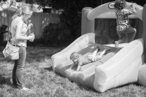 Jenn's backyard was the perfect spot for older kids to run around and for all guests to relax and participate in a variety of activities. Photo: Headrick's Photography