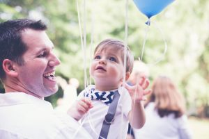 A sweet moment between father and son made possible by their photographer! Photo: Headrick's Photography