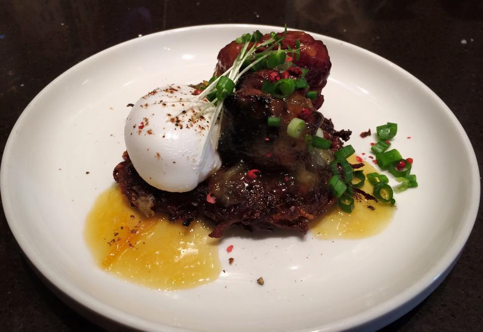 Kohlrabi Latke with pork belly confit, orange marmalade butter and a poached egg Photo: Feast Bakery