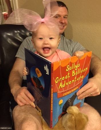 Reading with Daddy is SO fun! Photo: IDOPT